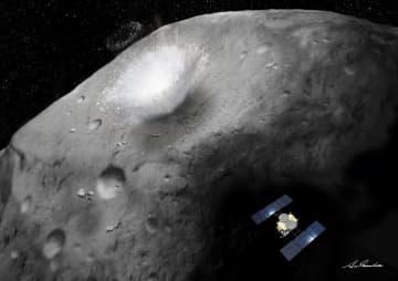 探査機はやぶさ2が分離した衝突装置が、小惑星表面にクレーターをつくる場面の想像図(JAXA提供)