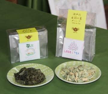 夢百姓が発売したハーブティー。手前は原料の杜仲茶(左)とマコモの葉