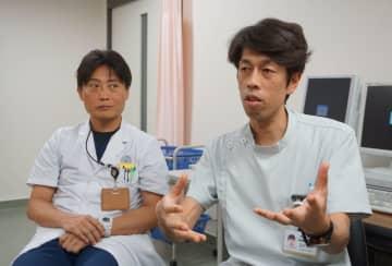 「症状は前触れなく起こる」と話す立石医師(右)と高畠医師=長崎市坂本1丁目、長崎大学病院