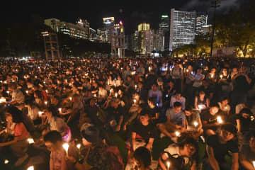 2018年6月4日、香港の民主派団体が主催した天安門事件追悼集会(共同)