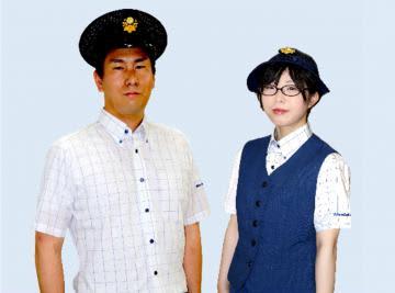 新制服を着用した男性社員と女性社員