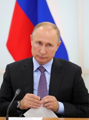ロシア極東アムール州で会合を開くプーチン大統領=6日(タス=共同)