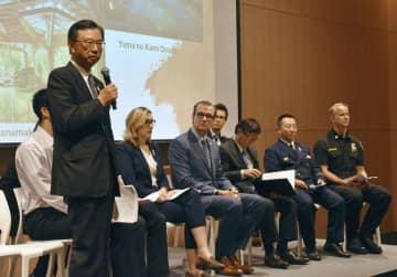 イベントで話す岩手県花巻市の上田東一市長=25日、米ロサンゼルス(共同)