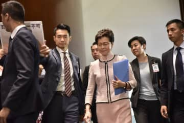 Chief Executive Carrie Lam enters the Chamber of the Legislative Council Complex in order to deliver her 2019 Policy Address. Photo: inmediahk.net.