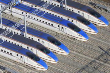 台風19号による大雨で一時水に漬かった北陸新幹線の車両=17日午後、長野市赤沼(共同通信社ヘリから)