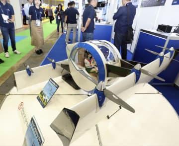 「CEATEC2019」で公開されたエアロネクストの試作機「空飛ぶゴンドラ」=15日、千葉市の幕張メッセ