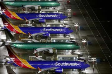 米シアトルの空港に駐機するボーイング737MAX=20日(ロイター=共同)