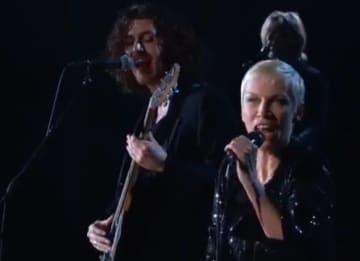 Hozier performs with Annie Lennox at the GRAMMYs