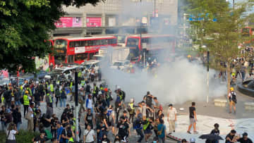 Tear gas outside Peninsula Hotel. Photo: Studio Incendo.