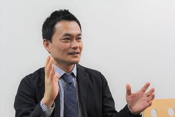 Hajime Miyazaki, director of NTT Ltd., speaks in an interview with NNA in Singapore on Oct. 17, 2019.