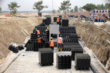 The installation work of Sekisui Chemical Co.'s Cross-Wave underground rainwater storage in a park in Bekasi Regency, West Java Province shown in a photo taken on Nov. 1, 2019.