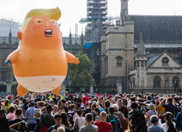 100,000 March To Protest Donald Trump In London With Baby Trump Balloon Looming Over