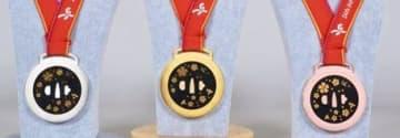 ハンドボール女子世界選手権で贈られる金、銀、銅のメダル(熊本国際スポーツ大会推進事務局提供)