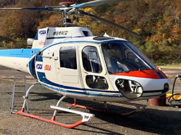 小型携帯電話基地局を搭載したヘリコプター