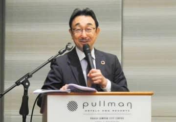 清水建設国際支店上席マネジャーの井上敏氏が、プロジェクト管理のノウハウや専門知識を解説した=13日、クアラルンプール(NNA撮影)