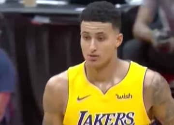Lakers' Kyle Kuzma throws passes at flag football NFL charity game