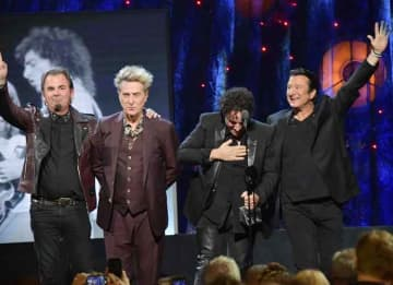 Journey inducted: Jonathan Cain, Ross Valory, Neal Schon, and Steve Perry of Journey onstage at the 32nd Annual Rock & Roll Hall Of Fame Induction Ceremony at Barclays Center.