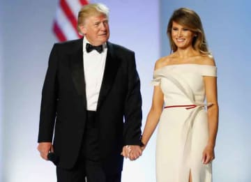 President Donald Trump and first lady Melania Trump arrive at the Freedom Inaugural Ball at the Washington Convention Center January 20, 2017 in Washington, D.C.
