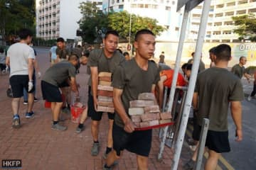 PLA personnel clear debris by Hong Kong Baptist University in Kowloon Tong. Photo: Kris Cheng/HKFP.