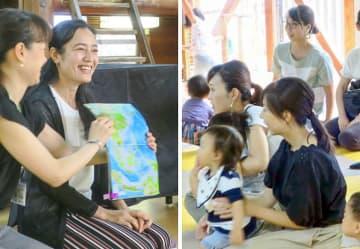 地図帳でカンボジアを紹介するチェンダさん(左)と、クメール語の読み聞かせを楽しむ親子=鴨池公園こどもログハウス(同所提供)