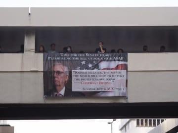 A banner at a protest on November 11. Photo: Benjamin Yuen/United Social Press.