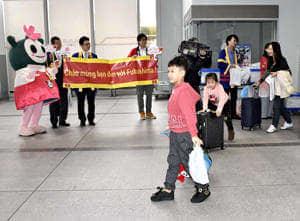 歓迎を受けるベトナムからの観光客