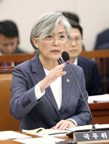 21日、ソウルの国会で答弁する韓国の康京和外相(聯合=共同)