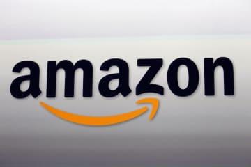 アマゾンのロゴ(AP=共同)
