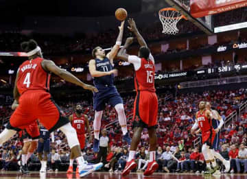 HOUSTON, TX - NOVEMBER 24: Luka Doncic #77 of the Dallas Mavericks shoots the ball over Clint Capela #15 of the Houston Rockets in the second half at Toyota Center on November 24, 2019 in Houston, Texas.