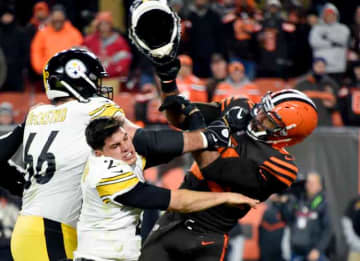 CLEVELAND, OHIO - NOVEMBER 14: Quarterback Mason Rudolph #2 of the Pittsburgh Steelers fights with defensive end Myles Garrett #95 of the Cleveland Browns during the second half at FirstEnergy Stadium on November 14, 2019 in Cleveland, Ohio....