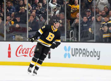 BOSTON, MASSACHUSETTS - DECEMBER 01: David Backes #42 of the Boston Bruins celebrates after scoring a goal against the Montreal Canadiens during the third period at TD Garden on December 01, 2019 in Boston, Massachusetts. The Bruins defeat the...