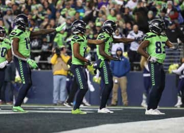 SEATTLE, WASHINGTON - DECEMBER 02: The Seattle Seahawks celebrate after a 60 yard touchdown by David Moore #83 of the Seattle Seahawks against the Minnesota Vikings in the third quarter during their game at CenturyLink Field on December 02,...