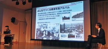 横浜市寿町の取り組みの紹介をする杉浦さん㊧と水島教授㊨