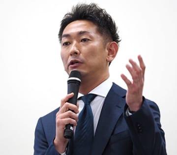 「SGホールディングスグループにおけるIT戦略の歩みと今後の展望」と題し講演するSGシステムの谷口友彦社長