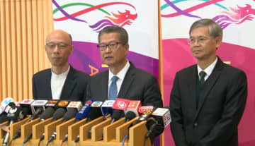 Paul Chan (middle). Photo: RTHK screenshot.