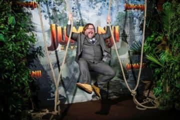 没入感のある映画体験を提供する技術が来週、ロサンゼルスの映画館で上映される『ジュマンジ/ネクスト・レベル』で米国デビューする。写真は3日パリで開かれたプレミアでの出演俳優ジャック・ブラック。 - (2019年 ロイター/Benoit Tessier)