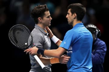1位に選ばれた「Nitto ATPファイナルズ」でのジョコビッチ(右)とティーム(左)