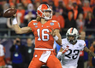 CHARLOTTE, NORTH CAROLINA - DECEMBER 07: Trevor Lawrence #16 of the Clemson Tigers drops back to pass against the Virginia Cavaliers during the ACC Football Championship game at Bank of America Stadium on December 07, 2019 in Charlotte, North...