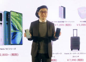 日本市場参入を表明した小米科技(シャオミ)のスティーブン・ワン氏=9日午後、東京都港区