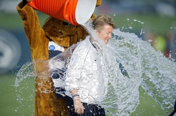 With help from the Penn State Nittany Lion, Penn State's athletic director Sandy Barbour completes the ALS ice bucket challenge on Friday, Aug. 22, 2014, at Jeffrey Field in University Park, Pa. - Abby Drey/Centre Daily Times/TNS