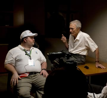 "Clint Eastwood and Paul Walter Hauser on the set of ""Richard Jewell."" - claire folger/Warner Bros./TNS"
