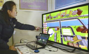 「全国教育科学成果展示会」で教育支援のソフトウエアを紹介する担当者=9日、平壌(共同)