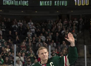 Mikko Koivu of the Minnesota Wild is honored for his 1,000th game on Tuesday, Dec. 10, 2019 at Xcel Energy Center in St. Paul, Minn. - Carlos Gonzalez/Minneapolis Star Tribune/TNS
