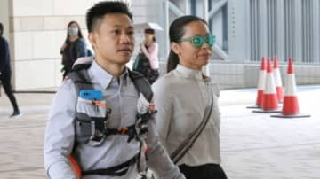 Henry Tong and Elaine To arriving at the court. File photo: Apple Daily.