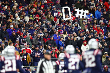 Fans hold a sign for the New England Patriots defense during the first half of the game against the Kansas City Chiefs at Gillette Stadium on Dec. 8, 2019 in Foxborough, Mass. - Adam Glanzman/Getty Images North America/TNS