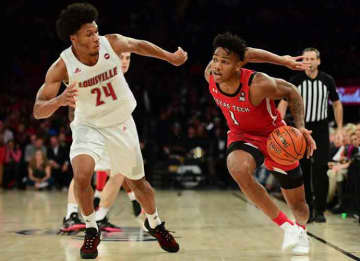 NEW YORK, NEW YORK - DECEMBER 10: Terrence Shannon Jr. #1 of the Texas Tech Red Raiders drives past Dwayne Sutton #24 of the Louisville Cardinals during the second half of their game at Madison Square Garden on December 10, 2019 in New York City.