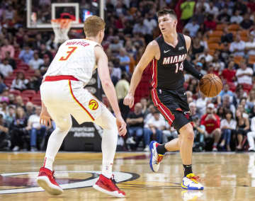 Miami Heat guard Tyler Herro (14) dribbles the ball during the first quarter against the Atlanta Hawks on Tuesday, Dec. 10, 2019 at AmericanAirlines Arena in Miami, Fla. - Daniel A. Varela/Miami Herald/TNS
