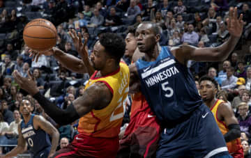 Jeff Green (22) of the Utah Jazz and Gorgui Dieng (5) Minnesota Timberwolves fought for the ball in the third quarter. - Carlos Gonzalez/Minneapolis Star Tribune/TNS