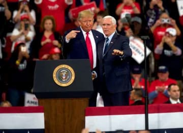 HERSHEY, PA - DECEMBER 10: U.S. President Donald Trump gestures with US Vice President Mike Pence during a campaign rally on December 10, 2019 in Hershey, Pennsylvania. This rally marks the third time President Trump has held a campaign rally...