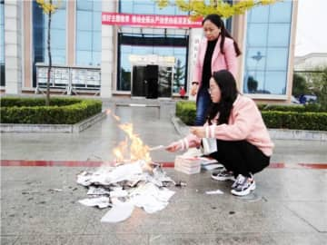 """Burning books and burying scholars"": A book burning causes uproar on Chinese social media"